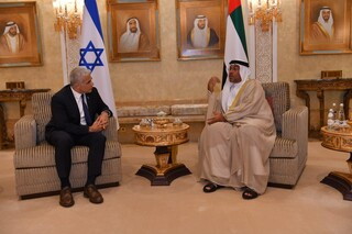 Foreign Minister Yair Lapid and Emirati Minister of State Ahmed Al Sayegh meeting at Abu Dhabi Airport Tuesday