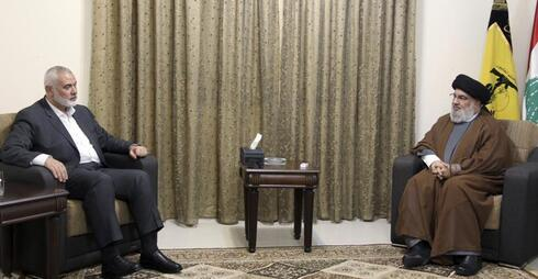 Hezbollah leader Sayyed Hassan Nasrallah, right, meeting with Ismail Haniyeh, the leader of the Palestinian militant group Hamas, in Beirut, Lebanon