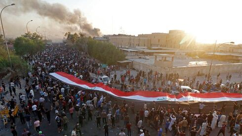 An archive picture showing Iraqis protesting in Basra over lack over power, July 2018
