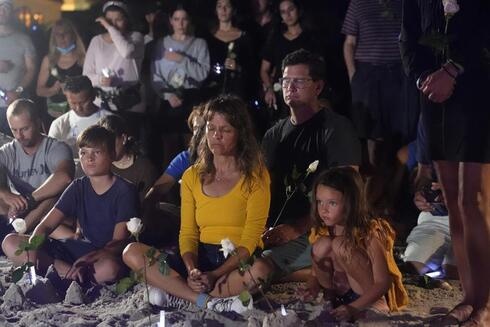 People gather at a vigil, late Monday, June 28, 2021, in Surfside, Fla