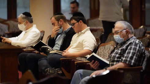 Jewish faithful pray at the Shul of Bal Harbour after members of the community were reported missing in the partial collapse of a 12-story beachfront condo