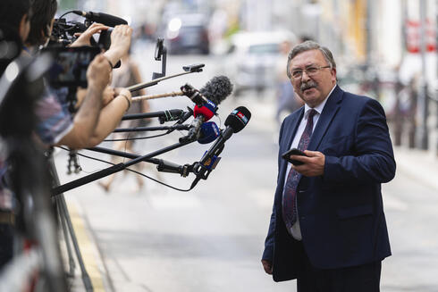 Russia's Governor to the International Atomic Energy Agency Mikhail Ulyanov speaking to reporters in Vienna in June