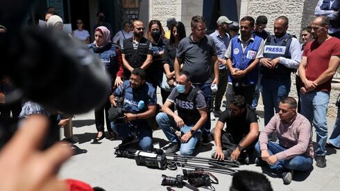 Journalists protest at the UN office in Ramallah to demand protection following attacks by Palestinian security forces on their colleagues, June 28, 2021