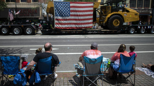 People sit in chairs to observe a 4th of July parade on July 4, 2021 in Pottstown, Pennsylvania