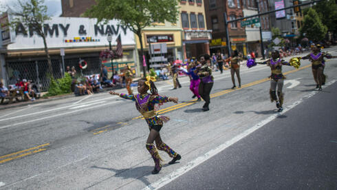 Dancers participate in a 4th of July parade on July 4, 2021 in Pottstown, Pennsylvania