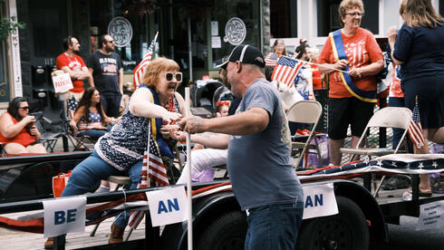 People participate in the annual Fourth of July parade on July 04, 2021 in Saugerties, New York