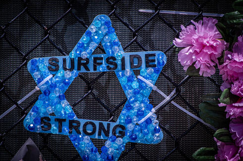 """A Magen David with the words """"Surfside Strong, at a memorial site near the collapsed building outside Miami"""