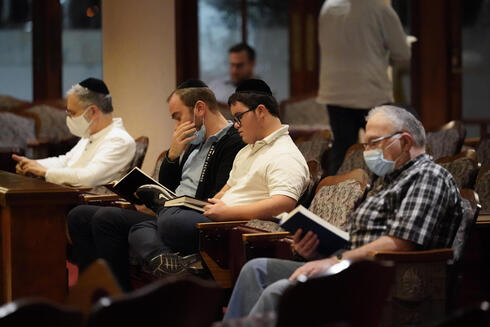Jewish faithful pray at the Shul of Bal Harbour near the collapsed Champlain South Towers in Surfside, Florida