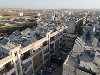 This aerial view shows solar panels on the rooftops of buildings in the town of Dana, east of the Turkish-Syrian border in the northwestern Syrian Idlib province, on June 10, 2021