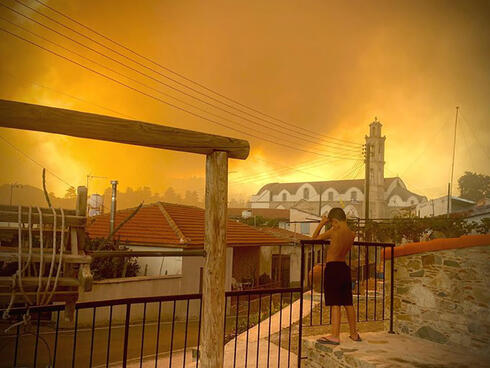 Smoke from a forest fire is seen in Ora village in Larnaca, in an image obtained from social media, July 3, 2021