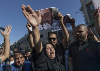 Maryam Banat, the mother of Palestinian Authority critic Nizar Banat, attends a protest in Ramallah over the death of her son in PA custody