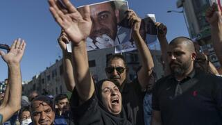 Maryam Banat, 67, mother of Palestinian Authority outspoken critic Nizar Banat chant ant Palestinian Authority slogans during a rally protesting his death, in the West Bank city of Ramallah