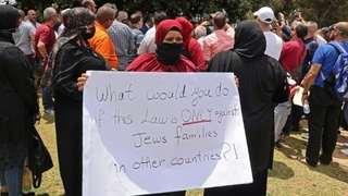 Israeli Arabs protest outside Knesset ahead of a vote on the Citizenship Law