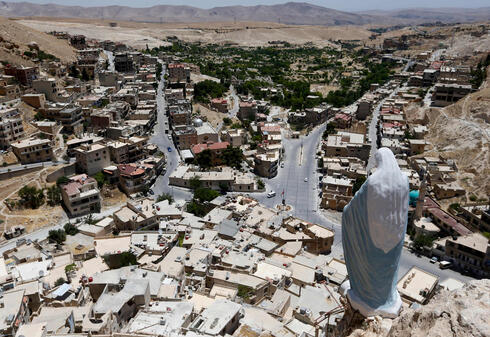 A statue of the Virgin Mary overlooks the village of Maalula