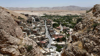 This picture shows a view taken from cliffs above the village of Maalula north of the Syrian capital Damascus
