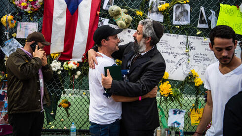 Friends and relative of the victims hug each other