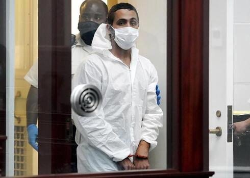 Khaled Awad is led into court while arraigned on charges in the stabbing of a rabbi near a Jewish day school, in Brighton District Court in Boston
