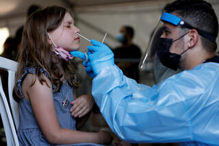 A child being tested for coronavirus at a testing facility in Tel Aviv