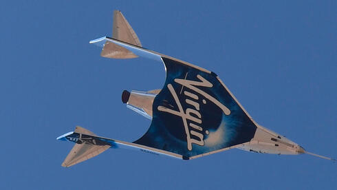 The Virgin Galactic SpaceShipTwo space plane Unity and mothership separate flying way above Spaceport America, near Truth and Consequences, New Mexico on July 11, 2021