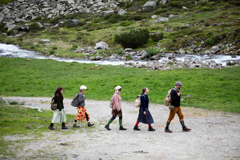 Actors of the theatre group Teatro Caprile reenact an emigration scene on the old Roman road on the Windbach Alp in the Krimmler Tauern Alps