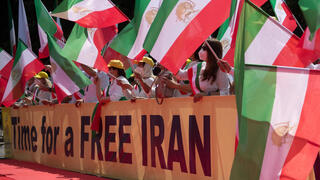 emonstrators take part in a protest called by the National Council of Resistance of Iran (NCRI) against the Iranian regime in front of the Brandenburg Gate in Berlin on July 10, 2021.
