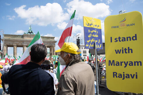 Demonstrators take part in a protest called by the National Council of Resistance of Iran (NCRI) against the Iranian regime in front of the Brandenburg Gate in Berlin on July 10, 2021