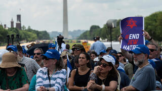 """People look during a rally on """"No Fear: a Rally in Solidarity With the Jewish People"""" on the National Mall in Washington, DC on July 11, 2021"""