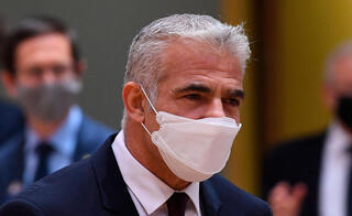 Foreign Minister Yair Lapid arrives for a Foreign Affairs Council meeting at the EU headquarters in Brussels