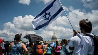A man holds an Israeli flag during a protest against anti-Semitism in Washington, July 11, 2021