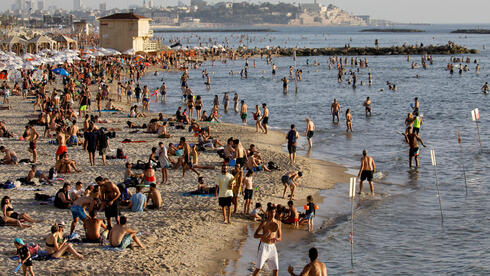 Beachgoers hang out on the shore of the Mediterranean Sea in Tel Aviv as coronavirus disease (COVID-19) restrictions eased in Israel May 21, 2020