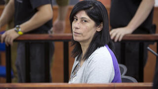 Palestinian Parliament member Khalida Jarrar of the PFLP attending a court session at the Israeli Ofer military base near the West Bank city of Ramallah