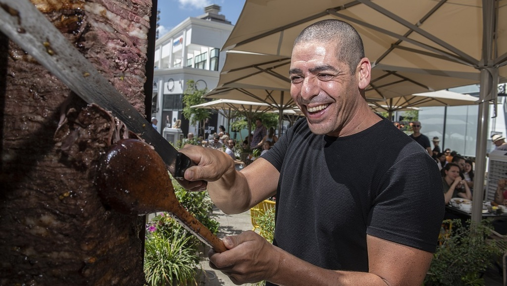 Yossi Shitrit with his giant doner stand