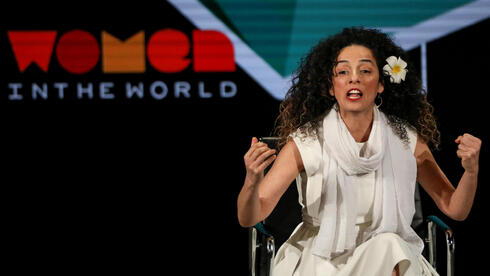 Masih Alinejad, Iranian journalist and women's rights activist, speaks on stage at the Women In The World Summit in New York, U.S, April 12, 2019