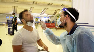 A man being tested for coronavirus at a testing facility at Ben-Gurion Airport