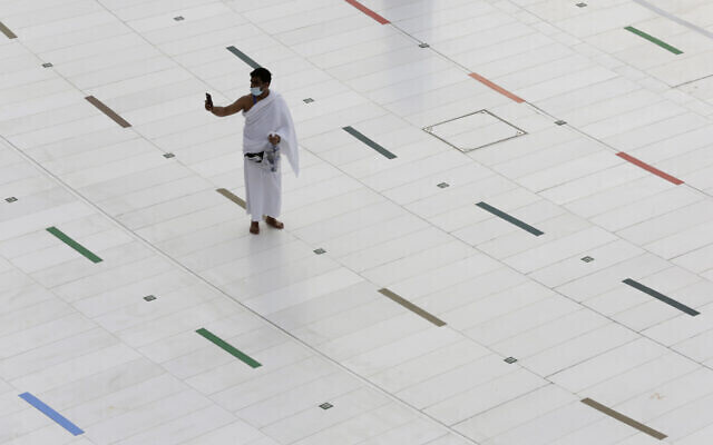A Muslim pilgrim takes a selfie at the Grand Mosque