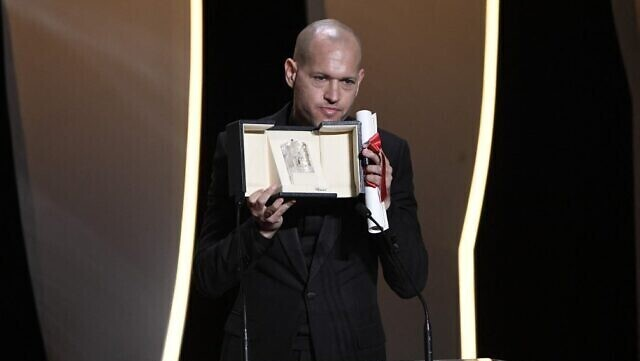 """Israeli director Nadav Lapid give a speech after he was awarded with the Jury Prize for the film """"Ha'Berech"""" during the closing ceremony of the Cannes Film Festival in Cannes, France"""
