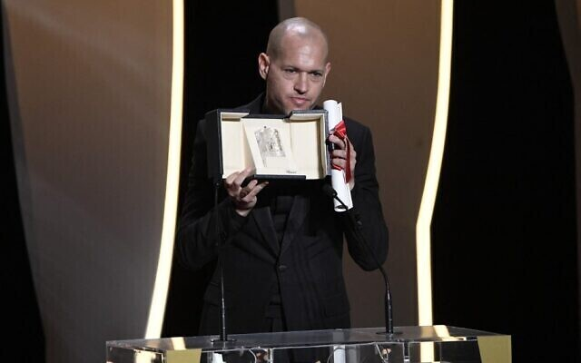 Israeli director Nadav Lapid gives a speech after he was awarded with the Jury Prize for the film 'Ha'Berech' during the closing ceremony of the Cannes Film Festival in Cannes, France