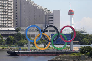 The Olympic rings float on a barge ahead of the 2020 Summer Olympics, Monday, July 19, 2021, in Tokyo