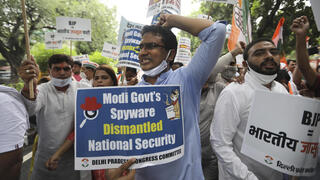 Congress party workers shout slogans during a protest accusing Prime Minister Narendra Modi's government of using malware from Israel-based NSO Group to spy on political opponents