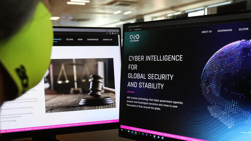A woman checks the website of Israel-made Pegasus spyware at an office in the Cypriot capital Nicosia on July 21, 2021