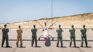 Drone pilots from five countries and Israel pose in front of a Hermes-450