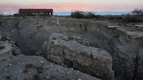 Sinkholes are seen at the abandoned tourist resort of Ein Gedi along the shore of the Dead Sea