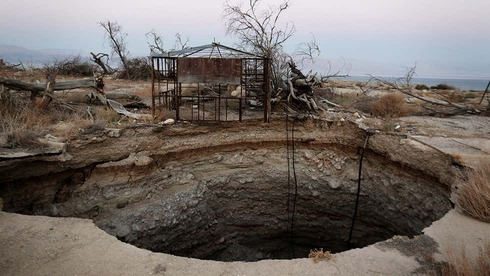 A large sinkhole is seen at the abandoned tourist resort of Ein Gedi along the shore of the Dead Sea