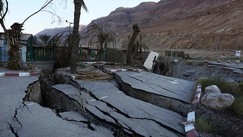 A view of a building that has collapsed into sinkholes in the abandoned Mineral Beach Resort on the shore of the Dead Sea