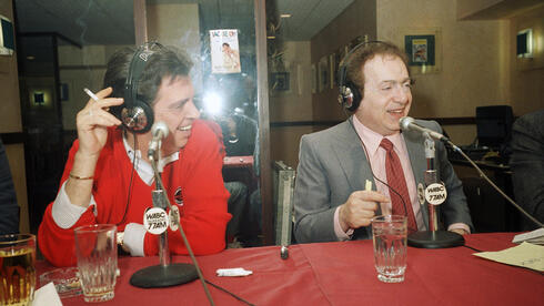 Jackie Mason, right, hosts TV personality Morton Downey Jr. during a live radio broadcast