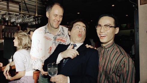 """Jackie Mason, holding a glass, enjoys a joke with John Lithgow, left, and B.D. Wong, stars of the Tony award-winning Broadway show """"M. Butterfly,"""
