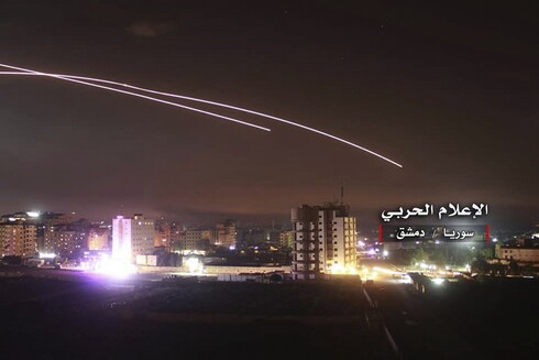 A photo provided by the pro-regime Syrian Central Military Media, shows anti-aircraft fire rise into the sky as Israeli missiles hit air defense positions and other military bases around Damascus, Syria,