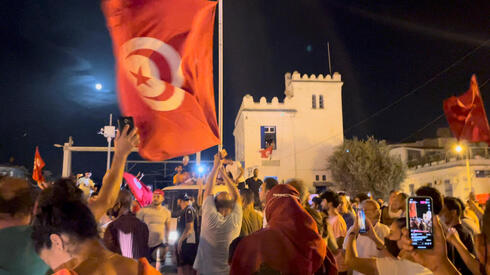 Crowds gather on the street after Tunisia's president suspended parliament, in La Marsa, near Tunis, Tunisia