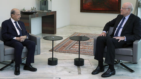 Lebanese President Michel Aoun, left, meets with former Lebanese Prime Minister Najib Mikati, at the presidential palace, in Baabda, east of Beirut, Lebanon