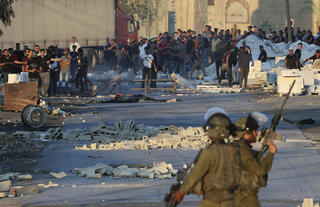 Palestinian protesters and IDF soldiers clash after funeral of child believed to have been killed by army fire
